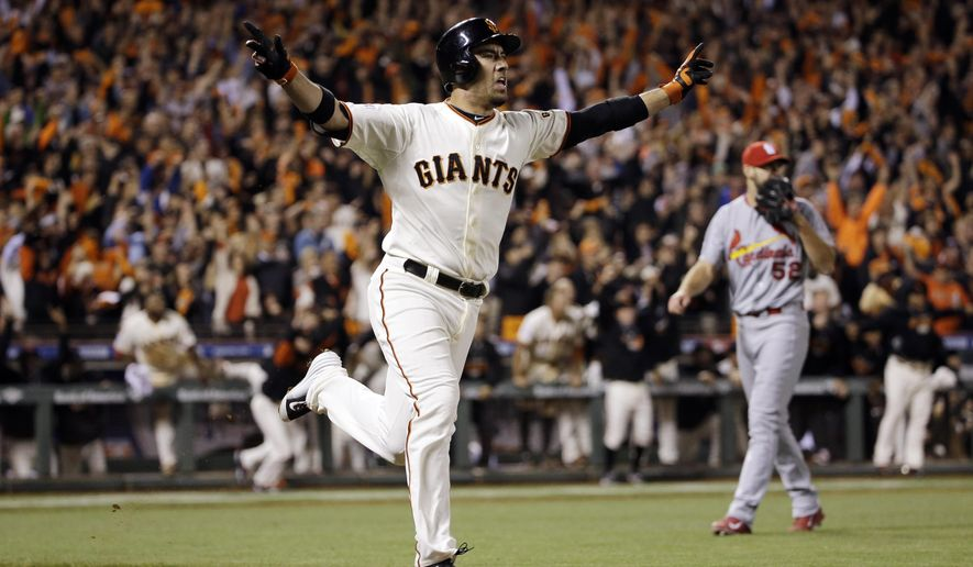 San Francisco Giants' Travis Ishikawa reacts after hitting a walk-off three-run home run during the ninth inning of Game 5 of the National League baseball championship series against the St. Louis Cardinals Thursday, Oct. 16, 2014, in San Francisco. The Giants won 6-3 to advance to the World Series.(AP Photo/David J. Phillip)