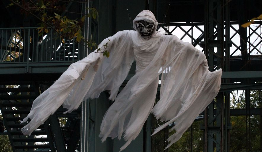 A flying ghost at King's Dominion's Halloween Haunt in Doswell, Virginia. (Photograph by Jacquie Kubin / Special to The Washington Times)