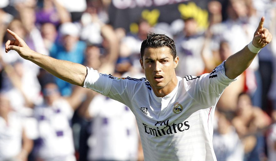 Real Madrid's Cristiano Ronaldo from Portugal celebrates scoring against Levante during a Spanish La Liga soccer match at the Ciutat de Valencia stadium in Valencia, Spain, on Saturday, Oct. 18, 2014. (AP Photo/Alberto Saiz)