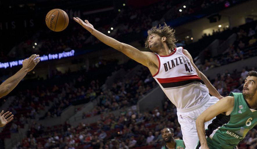 Portland Trail Blazers center Robin Lopez (42) misses a rebound against Maccabi Haifa's Anton Shoutvin at the Moda Center in Portland on Oct. 17, 2014. Bruce Ely / The Oregonianduring an NBA exhibition basketball game Friday, Oct. 17, 2014, in Portland, Ore. (AP Photo/The Oregonian, Bruce Ely)