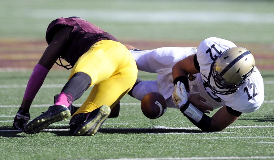 Minnesota defensive back Damarius Travis forces a fumble by Purdue quarterback Austin Appleby (12) on during the second half an NCAA college football game Saturday, Oct. 18, 2014, in Minneapolis. Minnesota won 39-38. (AP Photo/Hannah Foslien)
