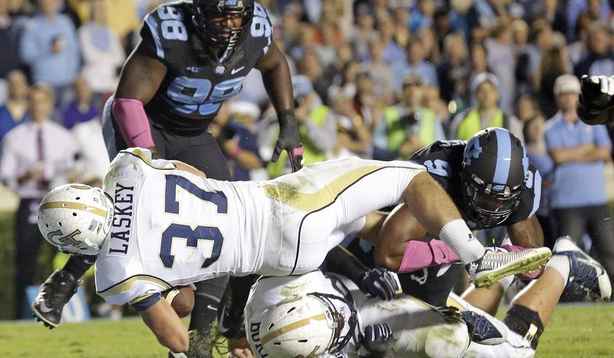 Georgia Tech's Zach Laskey (37) scores a touchdown during the first half of an NCAA college football game against North Carolina in Chapel Hill, N.C., Saturday, Oct. 18, 2014. North Carolina's Justin Thomason (98) and Travis Hughes (9) miss the tackle. (AP Photo/Gerry Broome)