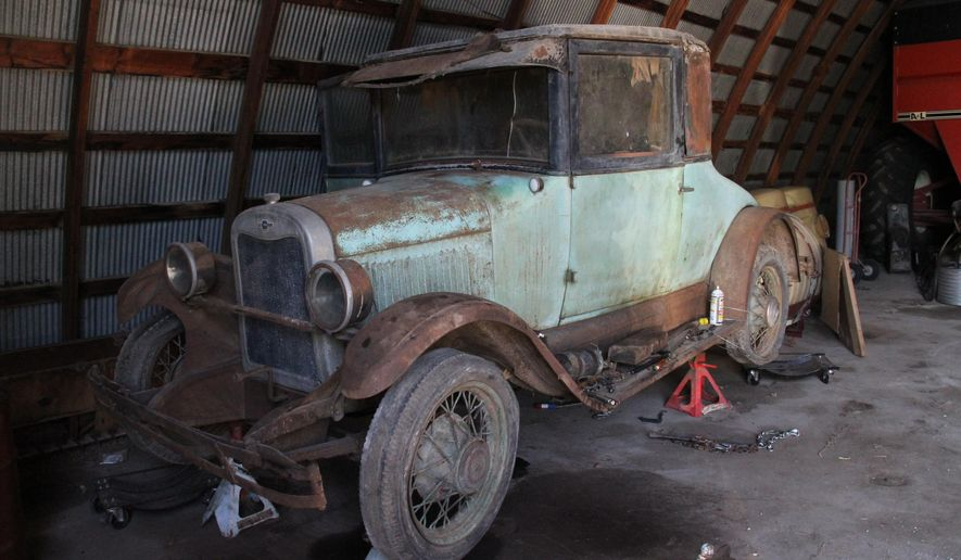 This photo taken on Sept. 29, 2014, shows a 1926 Chevy Coupe originally belonged to Henry P. Buller, grandfather of York, Neb. resident Paul Buller. Though it is in disrepair now, Paul, with his brothers Marvin and Ardell, hope to restore it to its former glory. (AP Photo/The York News-Times, Maegan Detlefs)