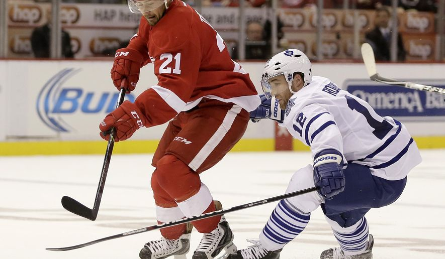 Detroit Red Wings' Tomas Tatar (21), of Slovakia, skates to the goal against Toronto Maple Leafs' Stephane Robidas during the second period of an NHL hockey games Saturday, Oct. 18, 2014, in Detroit. (AP Photo/Duane Burleson)