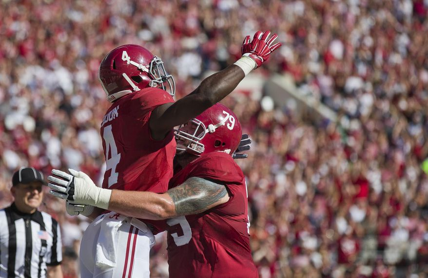 Alabama running back T.J. Yeldon (4) and offensive lineman Austin Shepherd (79) celebrate Yeldon's touchdown during the first half of an NCAA college football game against Texas A&M, Saturday, Oct, 18, 2014, in Tuscaloosa, Ala. (AP Photo/Brynn Anderson)