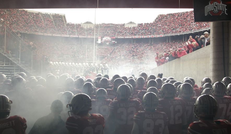 Ohio State players wait in the tunnel before an NCAA college football against Rutgers, Saturday, Oct. 18, 2014, in Columbus, Ohio. (AP Photo/Jay LaPrete)