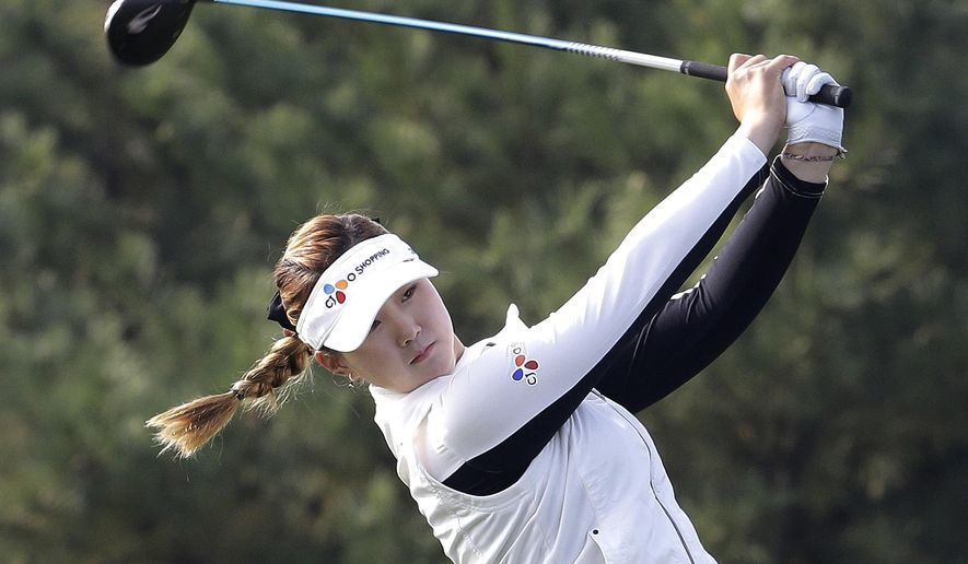Kyu Jung Baek of South Korea watches her shot on the 2nd hole during the third round of the LPGA KEB Hana Bank Championship golf tournament at Sky72 Golf Club in Incheon, South Korea, Saturday, Oct. 18, 2014. (AP Photo/Ahn Young-joon)