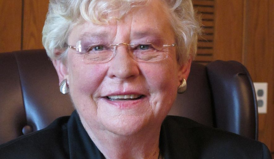 FILE - In this Wednesday, Oct. 8, 2014, file photo, Republican Lt. Gov. Kay Ivey poses for a portrait on 2014, in Montgomery, Ala. Ivey is seeking a second term Nov. 4 against former Democratic state Rep. James Fields. (AP Photo/Phillip Rawls, File)