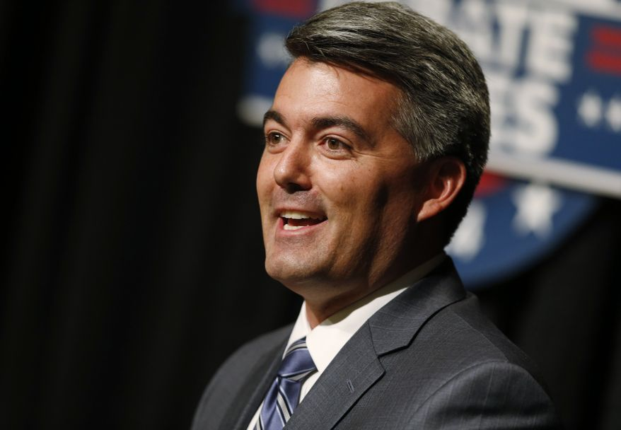 """In Colorado, analyst Stuart Rothenberg shifted the Senate contest's rating from """"pure tossup"""" to """"tossup/leans Republican,"""" reflecting a slew of recent polls showing Republican Rep. Cory Gardner running several points ahead of Democratic Sen. Mark Udall.  (AP Photo/David Zalubowski)"""
