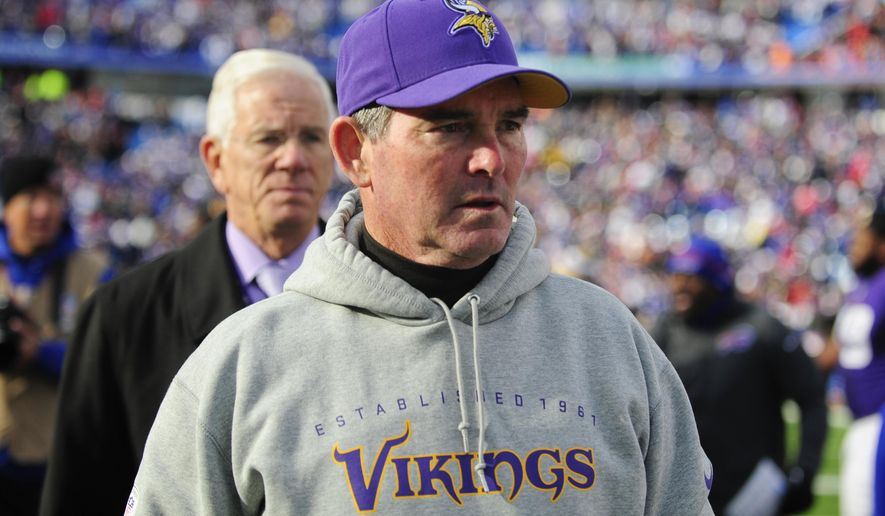 Minnesota Vikings head coach Mike Zimmer leaves the field after an NFL football game against the Buffalo Bills Sunday, Oct. 19, 2014, in Orchard Park, N.Y. The Bills won the game 17-16. (AP Photo/Gary Wiepert)