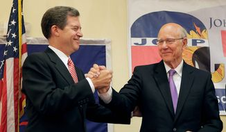 Kansas Gov. Sam Brownback (left) and Sen. Pat Roberts, both Kansas Republicans, are facing tough re-election bids that analysts say has more to do with candidate troubles than with dissatisfaction with the GOP. (Associated Press)