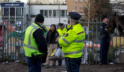 Dutch police have been evicting immigrants who have been staying in the Netherlands after their applications for asylum have been rejected. The government has taken an increasingly hard line on immigration to try to allay public concerns about overcrowding. (Associated Press)