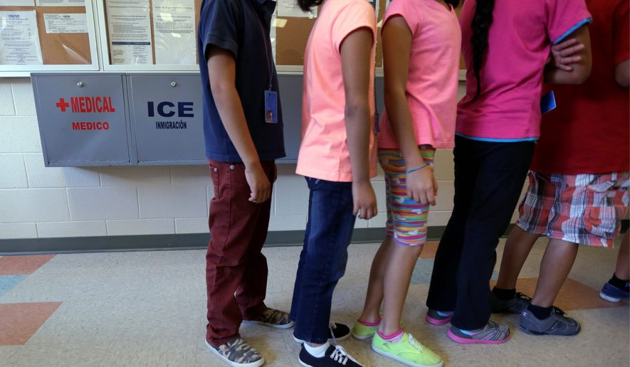 Detained immigrant children line up in the cafeteria at the  Karnes County Residential Center,  a temporary home for immigrant women and children detained at the border, in Karnes City, Texas. (Associated Press)