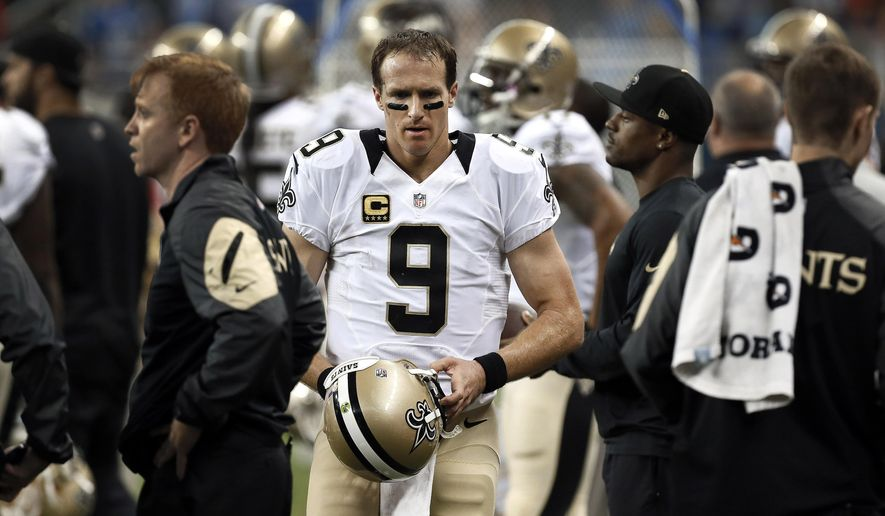 New Orleans Saints quarterback Drew Brees (9) walks on the sidelines after throwing an interception against the Detroit Lions in the fourth quarter of a NFL football game in Detroit, Sunday, Oct. 19, 2014. (AP Photo/Paul Sancya)