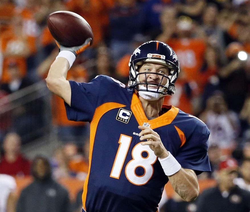 Denver Broncos quarterback Peyton Manning throws his 509th career touchdown pass to set the all time record during the first half of an NFL football game against the San Francisco 49ers, Sunday, Oct. 19, 2014, in Denver. Manning has broken Brett Favre's record for touchdown passes with his 509th. (AP Photo/Jack Dempsey)