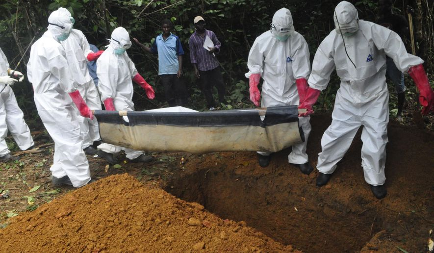 FILE : In this Saturday, Oct. 18, file photo a burial team in protective gear bury the body of a woman suspected to have died from Ebola virus in Monrovia, Liberia. The disease has ravaged a small part of Africa, but the international image of the whole continent is increasingly under siege, reinforcing some old stereotypes. (AP Photo/Abbas Dulleh, File)