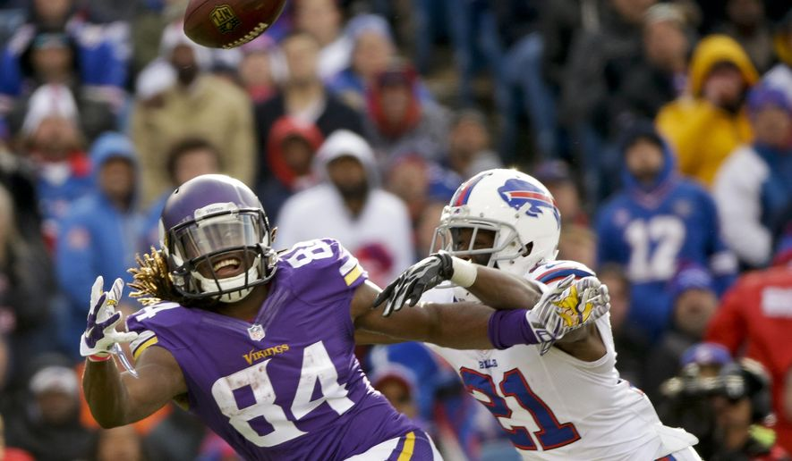 Minnesota Vikings wide receiver Cordarrelle Patterson (84) is defended by Buffalo Bills' Leodis McKelvin (21) during the second half of an NFL football game Sunday, Oct. 19, 2014, in Orchard Park, N.Y. (AP Photo/Bill Wippert)