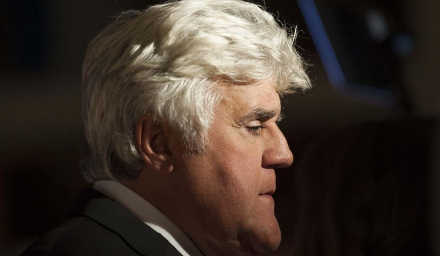 Jay Leno is interview on the red carpet as he arrives at the Kennedy Center for the Performing Arts for the Mark Twain Prize for American Humor on Sunday, Oct. 19, 2014.  (AP Photo/Kevin Wolf)