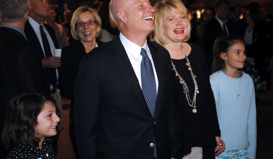 FILE - In this Nov. 6, 2012 file photo, U.S. Rep. Mike Coffman, R-Colo., second from left, jokes with his wife, Cynthia, third from left, as the couple is escorted to the stage during a Republican Party election night gathering in Denver. Colorado will have a new attorney general for the first time in nearly a decade, with voters deciding between Democrat Don Quick, a former district attorney, and Republican Cynthia Coffman, who is the current deputy attorney general. (AP Photo/David Zalubowski, file)