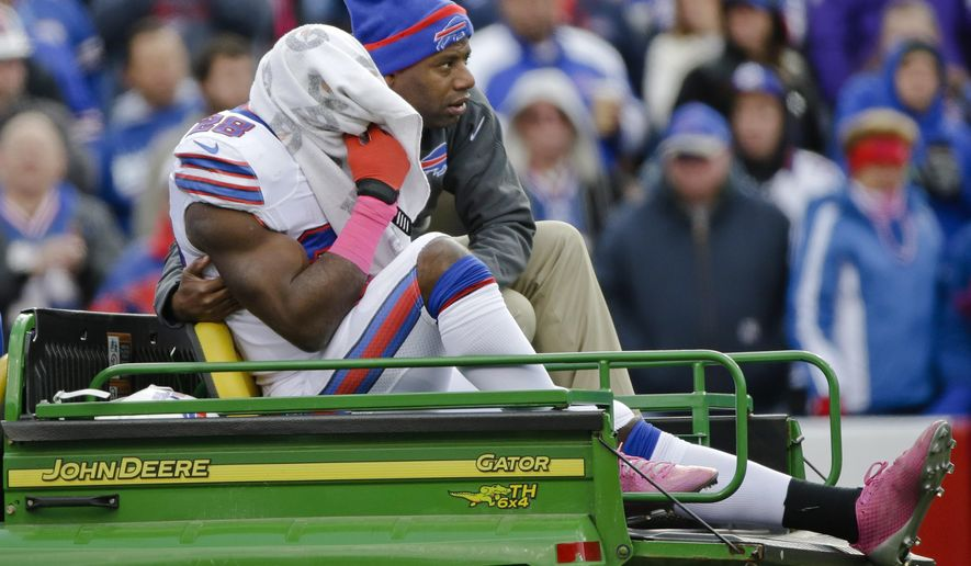 Buffalo Bills running back C.J. Spiller is comforted as he is carted off the field during the first half of an NFL football game against the Minnesota Vikings, Sunday, Oct. 19, 2014, in Orchard Park, N.Y.  (AP Photo/Bill Wippert)