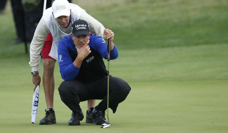 Henrik Stenson of Sweden lines up a putt on the 17th green during his semifinal World Match Play Championship game against George Coetzee of South Africa at the London golf club in Ash, England Sunday, Oct. 19, 2014. Stenson won the semifinal and will play Mikko Ilonen of Finland in the final. (AP Photo/Alastair Grant)