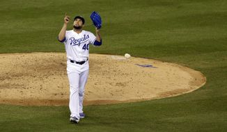 Kansas City Royals relief pitcher Kelvin Herrera reacts after the final out of the seventh inning of Game 3 of the American League baseball championship series against the Baltimore Orioles Tuesday, Oct. 14, 2014, in Kansas City, Mo. (AP Photo/Chris O'Meara)