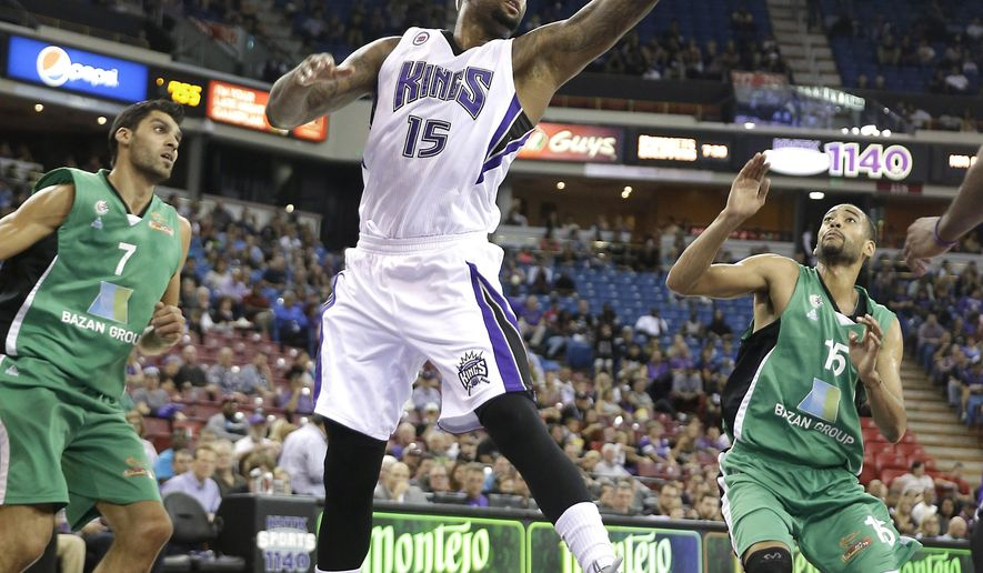 Sacramento Kings center DeMarcus Cousins, center, grabs a rebound between Maccabi Haifa's Alex Chubrevich, left, and Rene Rougeau, right, during the first quarter of an NBA basketball exhibition game in Sacramento, Calif., Saturday, Oct. 18, 2014. (AP Photo/Rich Pedroncelli)