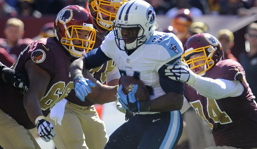 Washington Redskins guard Chris Chester, left, center Kory Lichtensteiger, center back, and tackle Tyler Polumbus, right, work to tackle Tennessee Titans inside linebacker Avery Williamson (54) after he got the ball on a turnover during the first half of an NFL football game, Sunday, Oct. 19, 2014, in Landover, Md. (AP Photo/Richard Lipski)