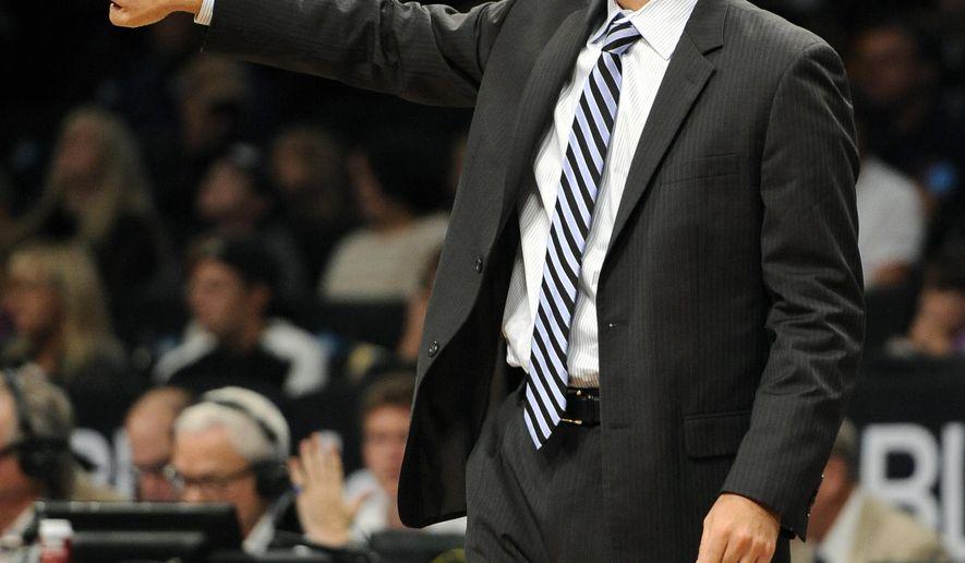 Boston Celtics head coach Brad Stevens directs his team during a preseason NBA basketball game against the Brooklyn Nets,  Sunday, Oct. 19, 2014, at Barclays Center in New York. The Celtics won 95-90. (AP Photo/Kathy Kmonicek)
