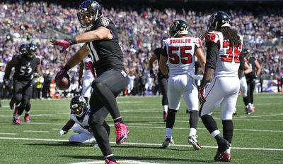 Baltimore Ravens tight end Owen Daniels (81) spikes the ball after scoring a touchdown in the first half of an NFL football game against the Atlanta Falcons, Sunday, Oct. 19, 2014, in Baltimore. (AP Photo/Nick Wass)