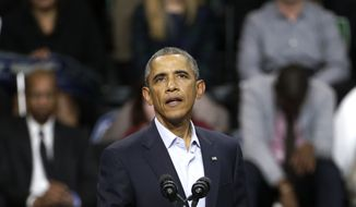 President Barack Obama pauses in his speech during an early voting and campaign rally for Illinois Gov. Pat Quinn at Chicago State University Sunday, Oct. 19, 2014, in Chicago. Early voting in Illinois starts Monday for the Nov. 4, election. (AP Photo/Charles Rex Arbogast)