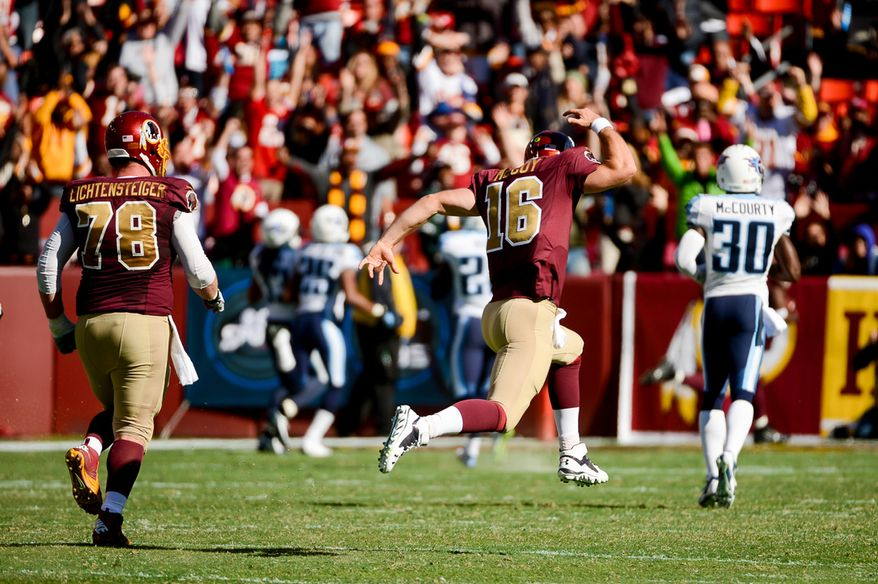 Washington Redskins quarterback Colt McCoy (16), who took over as quarterback after halftime, celebrates and runs down the field after throwing a short pass to Washington Redskins wide receiver Pierre Garcon (88) who runs for a 70 yard touchdown on the second offensive play of the 3rd quarter as the Washington Redskins play the Tennessee Titans at FedEx Field, Landover, Md., Sunday, October 19, 2014. (Andrew Harnik/The Washington Times)