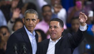 President Barack Obama and Maryland Gubernatorial Democrat candidate Lt. Governor Anthony Brown campaign at an Early Vote Rally at Dr. Henry Wise High School in Upper Marlboro, Md., Sunday, Oct. 19, 2014. This is Obama's first major campaign appearances of the midterm elections. Brown lost to Republican Larry Hogan in a shocker on election night (AP Photo/Cliff Owen)