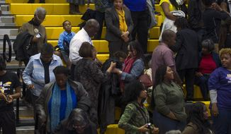 People departing high school gym where President Obama was addressing a campaign rally for Maryland Democrat gubernatorial candidate Lt. Gov. Anthony Brown in Upper Marlboro, Md., on Oct. 19. (AP Photo/Cliff Owen)