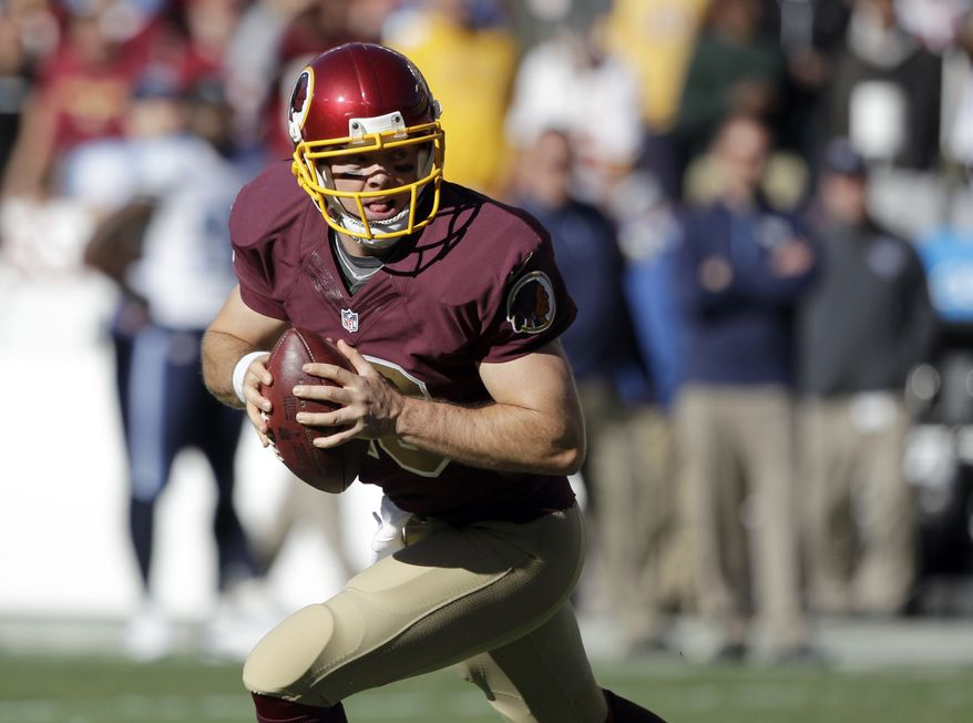 Washington Redskins quarterback Colt McCoy (16) rolls out to pass during the second half of an NFL football game against the Tennessee Titans, Sunday, Oct. 19, 2014, in Landover, Md. (AP Photo/Mark E. Tenally)