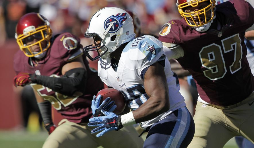 Tennessee Titans running back Bishop Sankey (20) runs with the ball as he's pursued by Washington Redskins inside linebacker Keenan Robinson (52) and defensive end Jason Hatcher (97) during the second half of an NFL football game, Sunday, Oct. 19, 2014, in Landover, Md. (AP Photo/Mark E. Tenally)