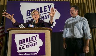 Senate candidate Bruce Braley, right,  campaigns with  U.S. Sen. Elizabeth Warren, D-Mass., in an Iowa Votes rally in Des Moines  Sunday, Oct. 19, 2014, at the Hotel Fort Des Moines . (AP Photo/The Des Moines Register, Rodney White)  MAGS OUT, TV OUT, NO SALES, MANDATORY CREDIT