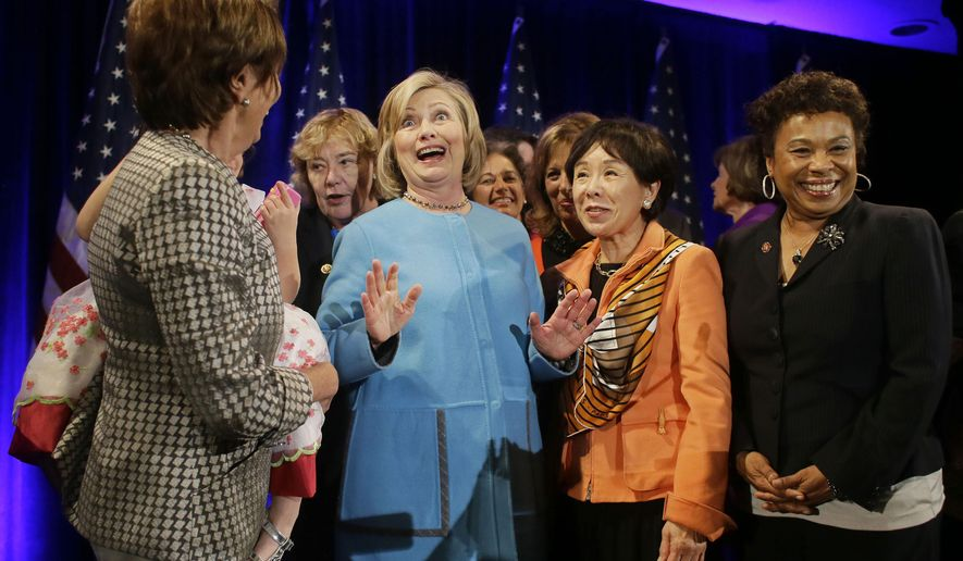Former Secretary of State Hillary Rodham Clinton, center, gathers with House Minority Leader Nancy Pelosi, left, Rep. Zoe Lofgren, second from left, Rep. Doris Matsui, second from right, and Rep. Barbara Lee, right, for a photo after speaking at a fundraiser for Democratic congressional candidates hosted by Pelosi at the Fairmont Hotel, Monday, Oct. 20, 2014, in San Francisco. (AP Photo/Eric Risberg)