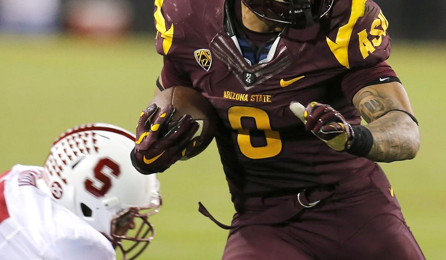 Arizona State running back D.J. Foster (8) rns against Stanford during the second half of the NCAA college football game, Saturday, Oct. 18, 2014, in Tempe, Ariz. (AP Photo/Rick Scuteri)