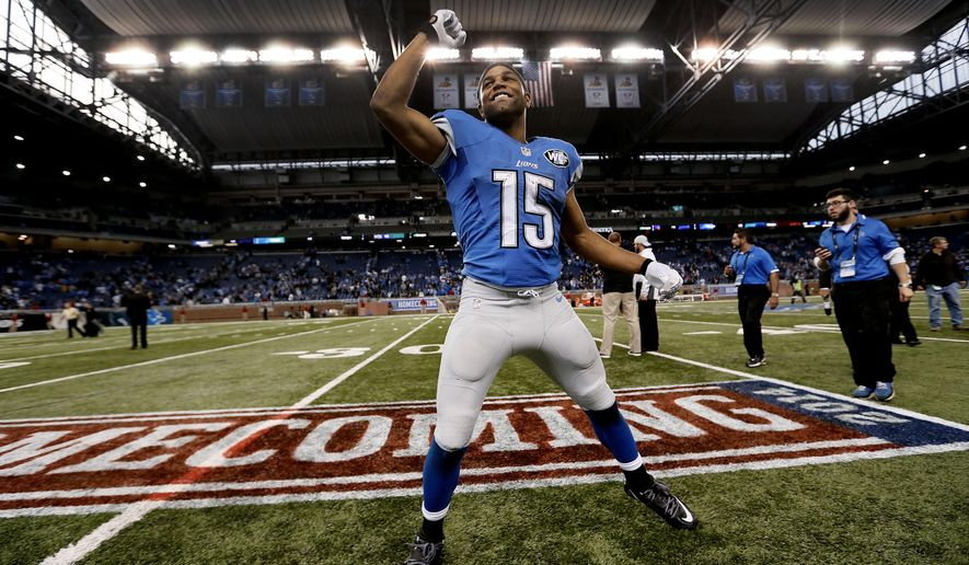 Detroit Lions wide receiver Golden Tate celebrates their 24-23 victory over the New Orleans Saints after a NFL football game in Detroit, Sunday, Oct. 19, 2014. (AP Photo/Paul Sancya)