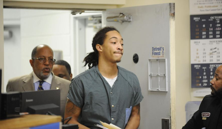 Cass Tech high school football standout Jayru Campbell enters a courtroom at 36th District Court in Detroit on Monday, Oct. 20, 2014. Camptbell was at a preliminary hearing.    (AP Photo/Detroit News, David Coates)  DETROIT FREE PRESS OUT; HUFFINGTON POST OUT