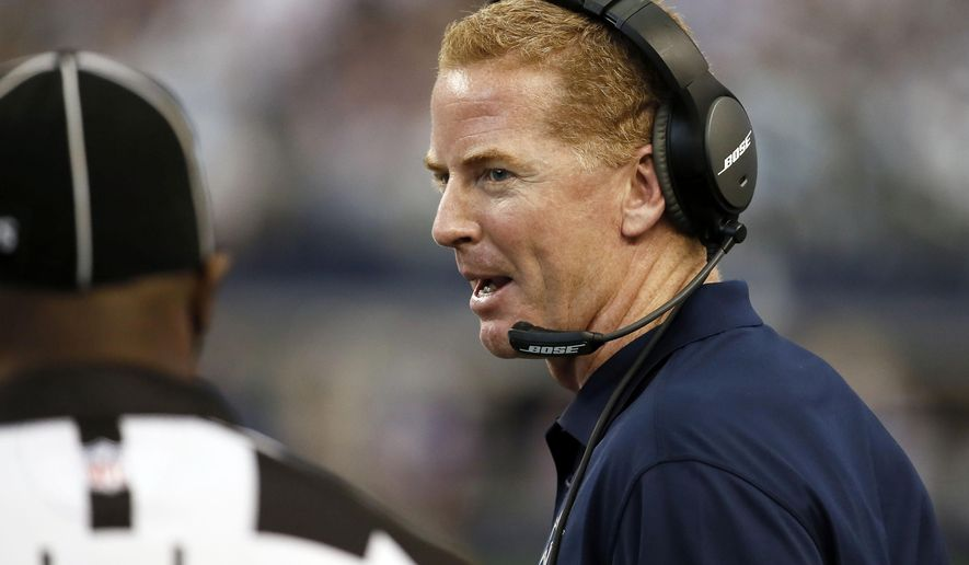 Dallas Cowboys head coach Jason Garrett talks to an official on the sideline during the first half of an NFL football game against the New York Giants, Sunday, Oct. 19, 2014, in Arlington, Texas. (AP Photo/Brandon Wade)