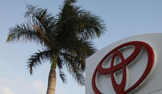FILE - This Feb. 3, 2010 file photo shows a palm tree behind a Toyota sign at Earl Stewart Toyota in North Palm Beach, Fla. Toyota is recalling 247,000 vehicles in high-humidity areas as an air bag problem that has plagued most of the auto industry continues to widen. The recall covers vehicles in South Florida, along the Gulf Coast, in Puerto Rico, Hawaii, the U.S. Virgin Islands, Guam, Saipan and American Samoa. (AP Photo/Wilfredo Lee, File)