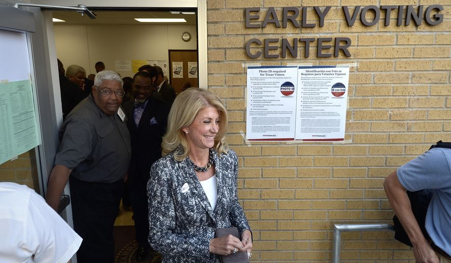 Texas gubernatorial Democratic candidate Wendy Davis exits the Early Voting Center after casting her vote on the first day of early voting at the Charles Griffin Sub-Courthouse, in Fort Worth, Texas,  Monday, Oct. 20, 2014.  Davis is running against against Republican Texas Attorney General Greg Abbott. U.S. Rep. (AP Photo/The Fort Worth Star-Telegram, Max Faulkner)  MAGS OUT; (FORT WORTH WEEKLY, 360 WEST); INTERNET OUT
