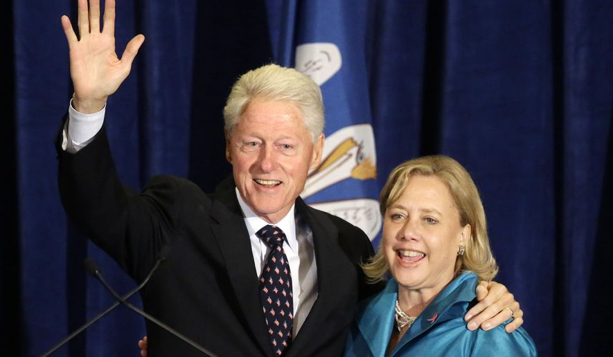 Former President Bill Clinton waves to the crowd with Sen. Mary Landrieu, D-La., at a campaign event for her senate race in Baton Rouge, La., Monday, Oct. 20, 2014. (AP Photo/Gerald Herbert)