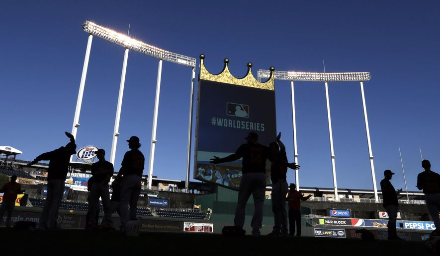 San Francisco Giants players stretch during baseball practice Monday, Oct. 20, 2014, in Kansas City, Mo. The Kansas City Royals will host the Giants in Game 1 of the World Series on Oct. 21. (AP Photo/David J. Phillip)