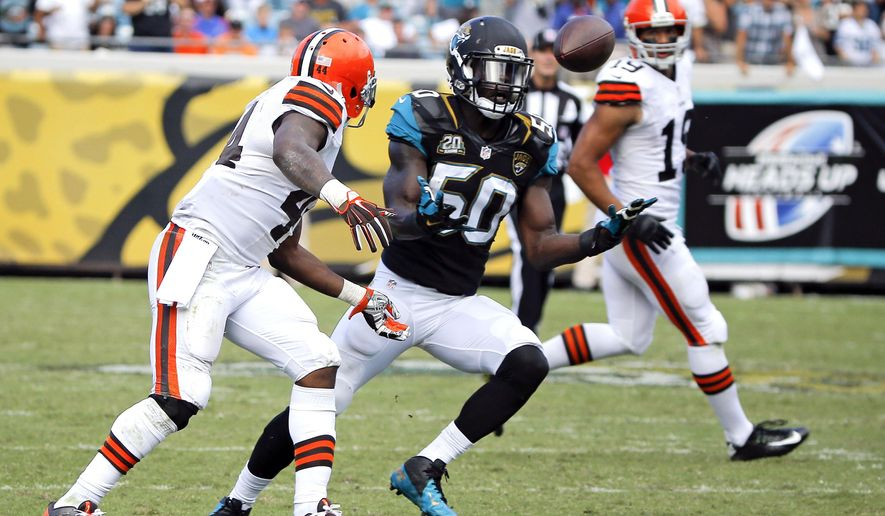 Jacksonville Jaguars outside linebacker Telvin Smith (50) intercepts a pass in front of Cleveland Browns running back Ben Tate, left, during the second half of an NFL football game in Jacksonville, Fla., Sunday, Oct. 19, 2014. (AP Photo/Stephen B. Morton)