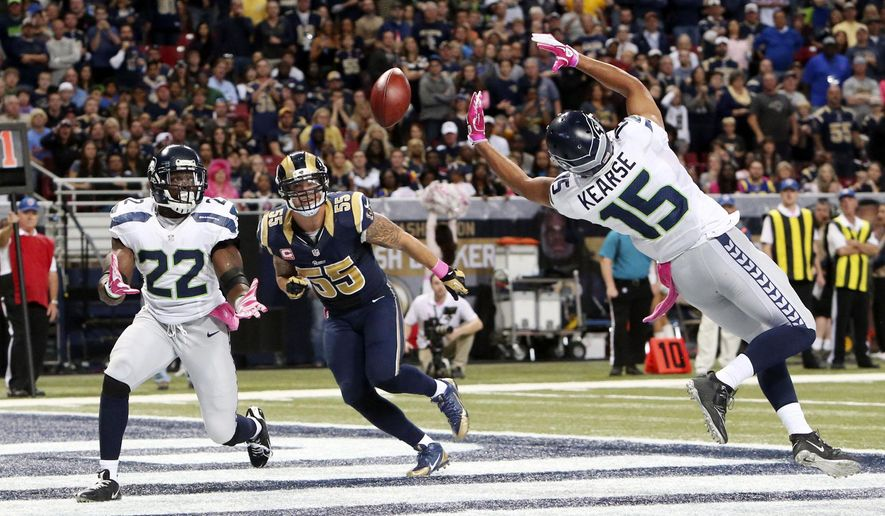 Seattle Seahawks running back Robert Turbin, left, and Jermaine Kearse are unable to catch a pass in the end zone as St. Louis Rams linebacker James Laurinaitis (55) defends on a two-point conversion attempt in fourth quarter action during an NFL football game Sunday, Oct. 19, 2014, at the Edward Jones Dome in St. Louis. (AP Photo/St. Louis Post-Dispatch, Chris Lee)