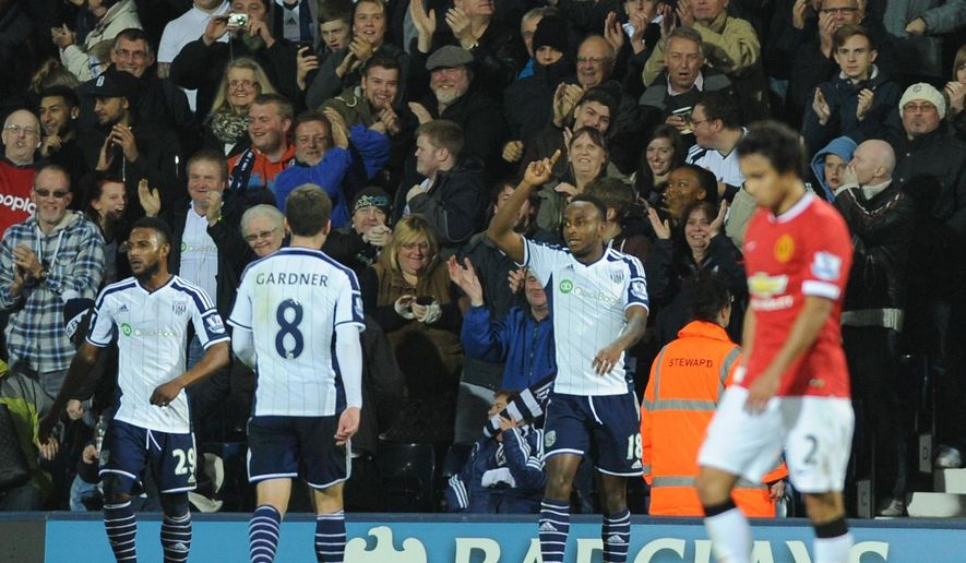 West Bromich Albion's Saido Berahino celebrates after scoring against Manchester United during the English Premier League soccer match between West Bromwich Albion and Manchester United at the Hawthorns, Birmingham, England, Monday, Oct. 20, 2014. (AP Photo/Rui Vieira)