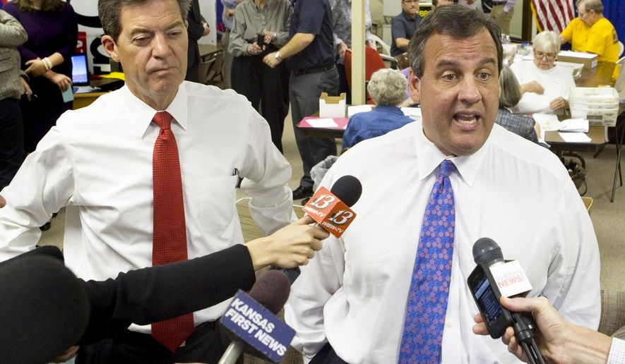 New Jersey Gov. Chris Christie, right, appeared at the Kansas Republican headquarters in Topeka, Kan., on Monday, Oct. 20, 2014, with Kansas Gov. Sam Brownback. Christie was in town to campaign for Brownback and thank the volunteers working at the office. (AP Photo/Topeka Capital-Journal, Thad Allton)